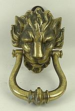 A cast iron door knocker, mid to late 20th century, modelled