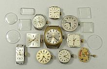 A quantity of lady's watch movements and crystals.