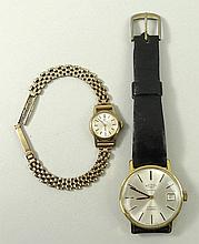 A lady's 9ct gold cased Omega wristwatch, circular champagne