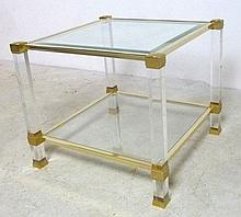 A Pierre Vandel, Paris, brass and bevelled glass occasional