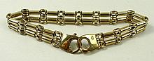 A 9ct gold double bar link bracelet on a snap clasp, 17.8g.