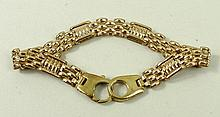 A 9ct rose gold gate and fancy link bracelet on a snap clasp