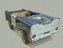 A 1960s child's Panda Police Car, with blue painted metal frame, 89 by 39 by 28cm high.