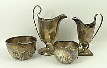 A silver helmet shaped cream jug, Robert Hennell and David Hennell, London 1795, another similar jug, Edward John Haseler & Noble Haseler, Chester 1906, letter engraved, and a Victorian cream jug and sugar bowl, Josiah Williams & Co, London 1895 and