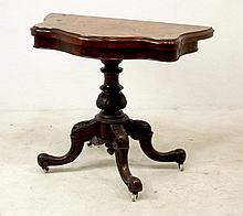 A Victorian burr walnut card table, the shaped top opens to reveal a circular baize lining, and swivels to reveal an interior well, with a baluster turned and carved column raised on four legs terminating with ceramic castors, 92 by 45 (90 extended)