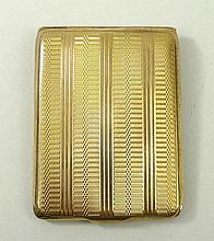 A 9ct gold match sleeve with engine turned decoration, Mappi
