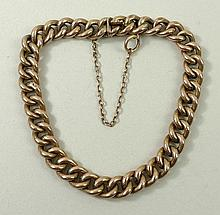A 9ct rose gold kerb link bracelet on a snap clasp, with saf