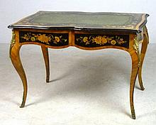 A Louis XIV French kingwood library table, the shaped top having a green tooled leather skiver, with floral marquetry inlaid ebony borders, the two shaped frieze drawers above tapered legs with gilt bronze mounts to the hip and cast sabots, 36 by 27