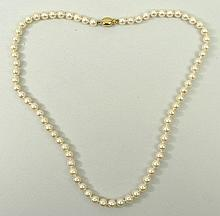 A cultured pearl necklace on a 9ct gold clasp, 46cm long.