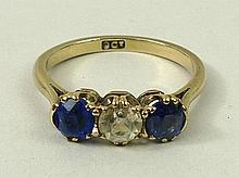 A 9ct gold white and blue Burmese sapphire three stone ring,
