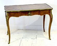A French Louis XVI style burr walnut and kingwood banded bureau plat, mid 20th century, of inverted rectangular form with brass mounts, single frieze drawer, raised on cabriole legs, 100 by 53 by 71.5cm high.