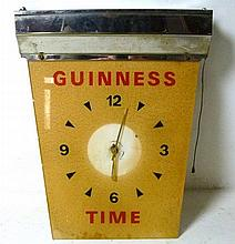 A Guinness 1970's Time Clock, with perspex painted face, 45