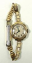 A Mimo lady's 9ct gold cased wristwatch, circular dial beari