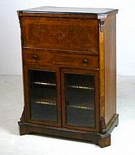 A Victorian burr walnut music cabinet, with fall front top compartment above a single drawer, the glazed cupboard doors enclosing shelves labelled Dance, Sacred Music, Songs, General Music in gilt lettering, 73 by 44 by 100cm high.