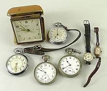 A 1920's 9ct gold lady's wristwatch with red painted numbers and a leather strap, four pocket watches, comprising; a Sekonda wristwatch, a Sphinx pocket watch, a Medana pocket watch, and an Ingersol pocket watch, and a Smiths travelling alarm clock.