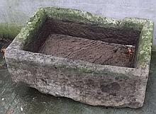 A 19th century deep carved stone rectangular