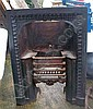 A Victorian cast iron fire grate, black