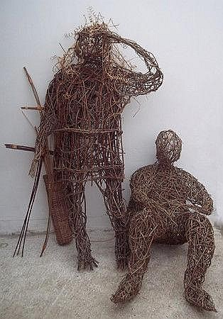 Two willow weave figures modelled, by Joni Bamford