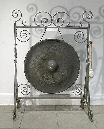 A bronze gong on wrought iron stand, 58cm