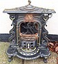 A Smith & Wellstood cast iron stove on feet,