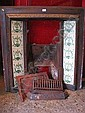 A mid 19th century cast iron fire surround, the sides inset with hand painted tiles in cream and green swags.