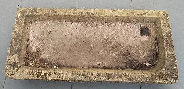A stone sink / trough used as a planter, 135 by 61