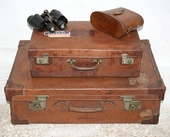 An early 20th century tan leather suitcase, 71 by