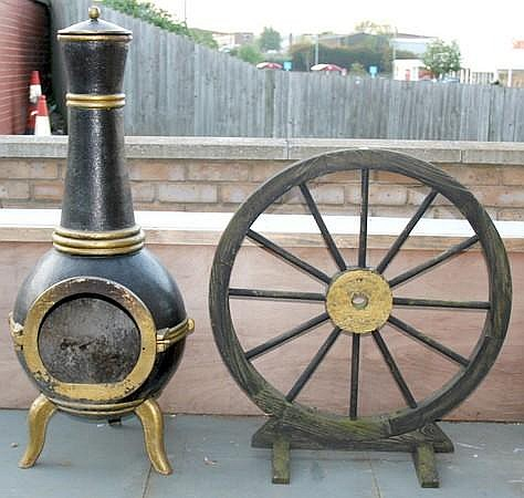 A cast iron wood burning stove with chimney and