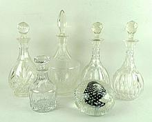 A pair of cut glass globe and shaft decanters with