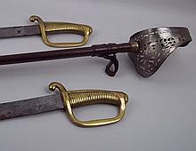 A pair of German military sabre's with brass grips