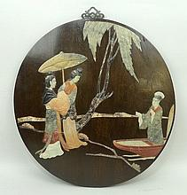 A Chinese roundel, inlaid with soapstone to depict