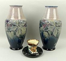 A pair of Royal Doulton stoneware vases of shoulde