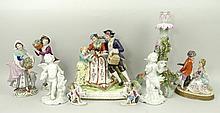 A pair of Sitzendorf porcelain figures modelled as