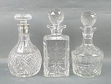 A group of cut glass decanters, comprising; an Edi