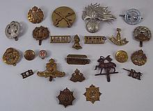 A quantity of military cap badges and buttons incl