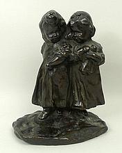 A 19th century bronze figure of two children, cast