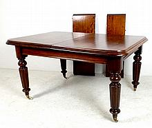 A Victorian mahogany extending dining table, with