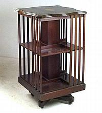 An Edwardian mahogany revolving bookcase, with a s