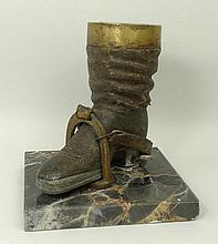 A Hungarian cast metal model of a hunting boot wit
