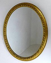 A 19th century giltwood oval wall mirror, 69 by 83