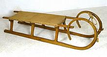 An oak framed two person sledge, stamped Bohemia,