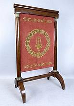 A French Empire mahogany fire screen, with rise an