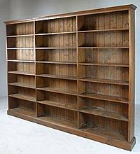 An early 20th century large pine bookcase, origina