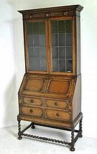 A fall front oak bookcase bureau in the Jacobean s