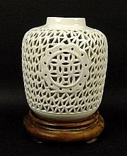 A modern Chinese reticulated porcelain blanc de chine vase