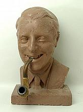 A 1950's tobacconists advertising plaster bust of a gentleman smoking a mee