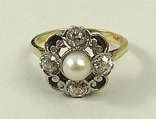 An 18ct gold and platinum set diamond and pearl ring