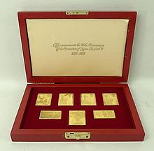 A group of seven gold plated sterling silver reproduction stamps