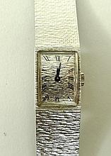 A lady's Bueche Girod 9ct white gold watch