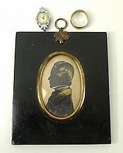 An early 19th century silhouette portrait miniature of a gentleman